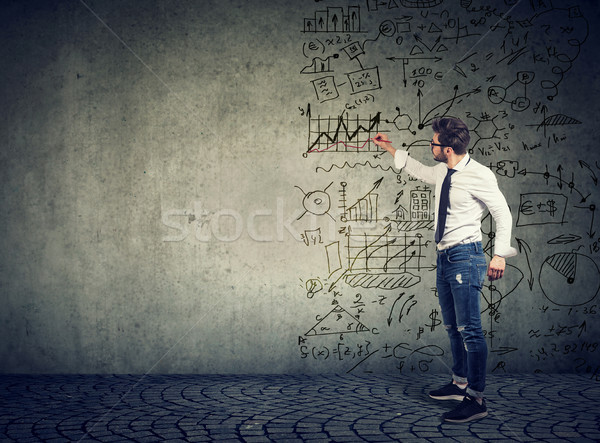Businessman standing and drawing business ideas  Stock photo © ichiosea