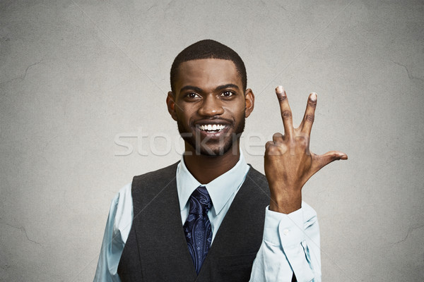 Company employee giving three times fingers gesture  Stock photo © ichiosea