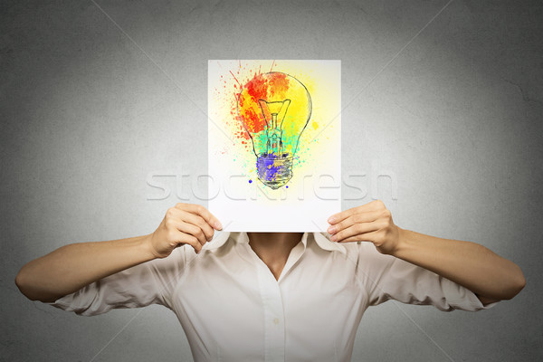 woman with colorful lightbulb covering face Stock photo © ichiosea