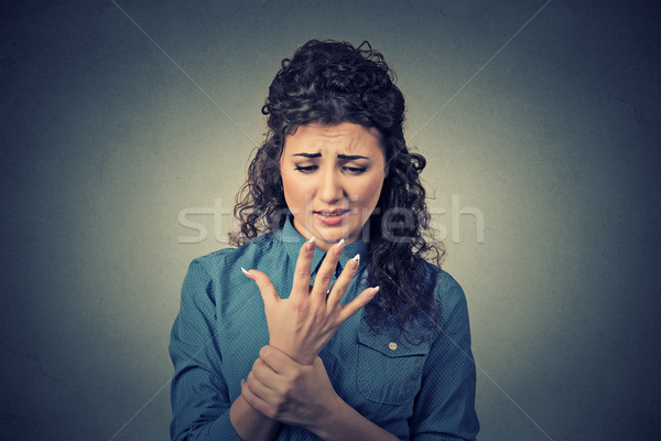 Young woman holding her painful wrist arm  Stock photo © ichiosea