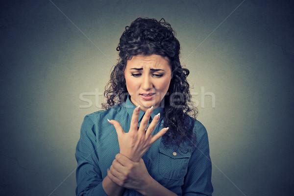 Mulher jovem doloroso pulso braço isolado Foto stock © ichiosea