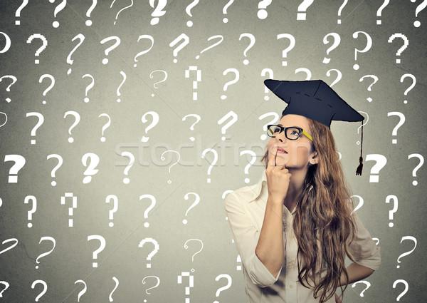 Figyelmes diplomás diák fiatal nő sok kérdőjelek Stock fotó © ichiosea