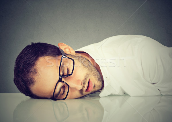 Man with glasses sleeping on a desk Stock photo © ichiosea