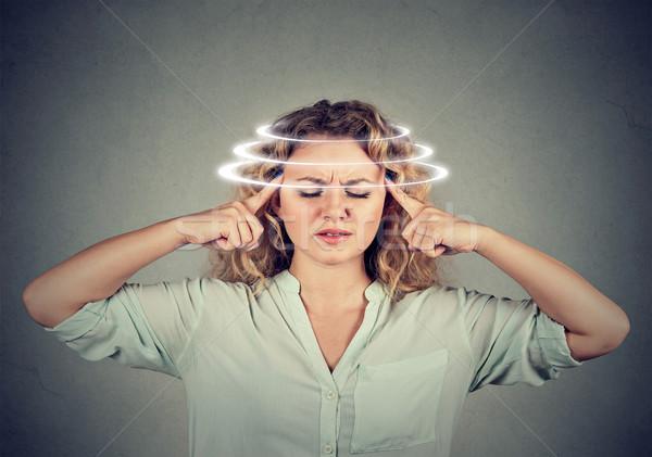 Woman with vertigo. Female patient suffering from dizziness Stock photo © ichiosea