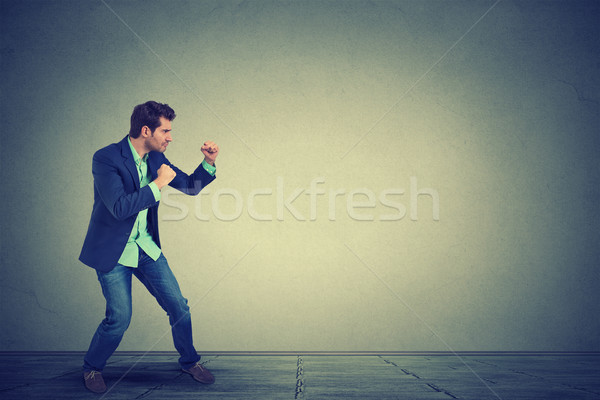 Man ready to fight with fists up in air  Stock photo © ichiosea