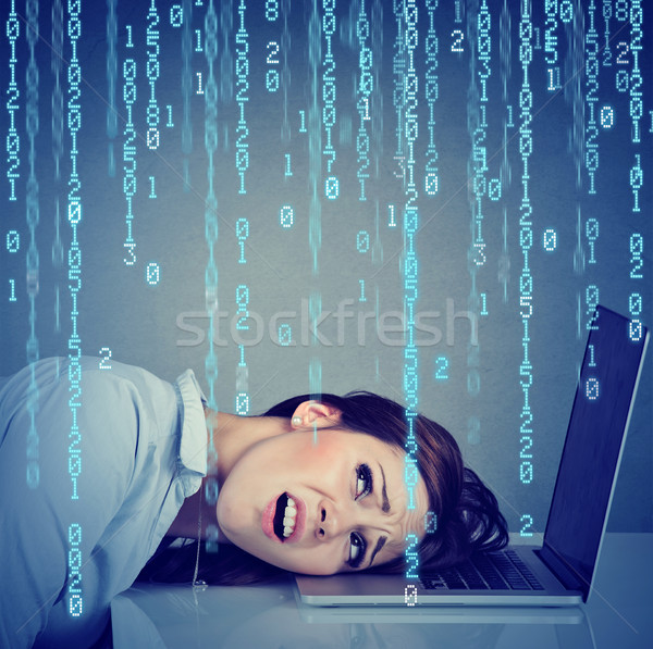 Desperate stressed woman resting head on laptop with binary code falling down   Stock photo © ichiosea