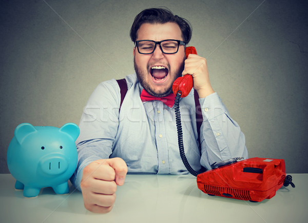 Bank employee screaming in phone handset Stock photo © ichiosea