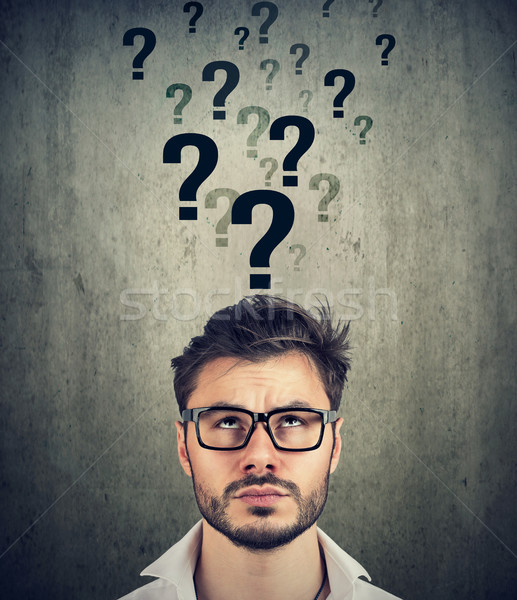 Man with too many questions and no answer   Stock photo © ichiosea