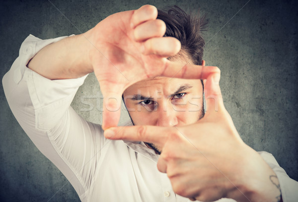 Man looking through a perfect frame Stock photo © ichiosea