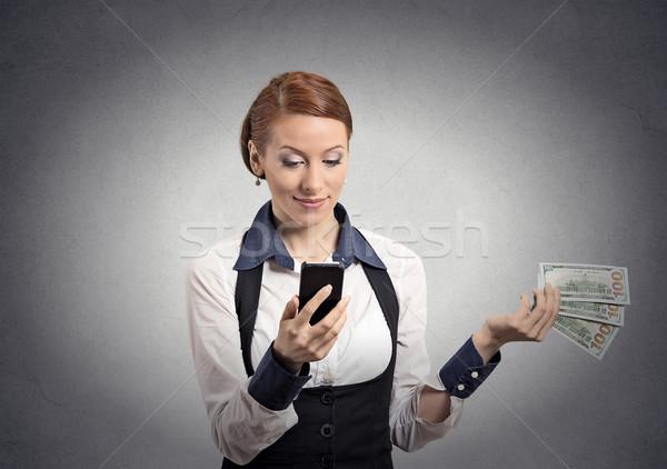 woman looking at smartphone throwing away cash dollar bills Stock photo © ichiosea