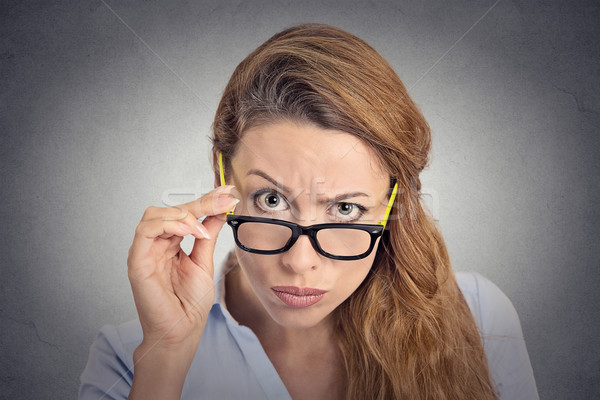 Headshot angry bitchy woman with glasses skeptically looking at you Stock photo © ichiosea