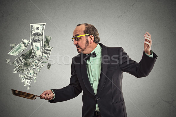 Meio idade empresário malabarismo dinheiro Foto stock © ichiosea