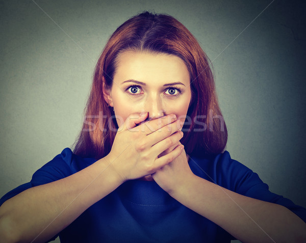 Concerned scared woman covering her mouth with hands  Stock photo © ichiosea