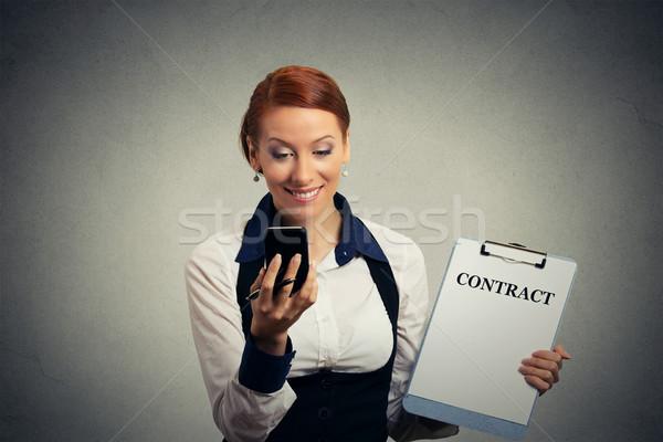 женщину мобильного телефона договор документы Сток-фото © ichiosea