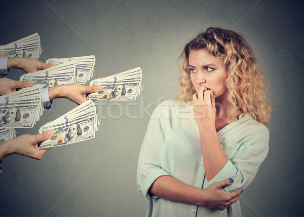 Woman hesitant to take bribe from people  Stock photo © ichiosea