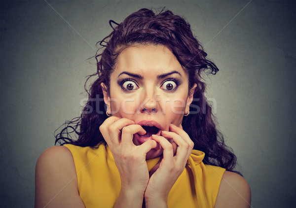 Scared shocked woman isolated on gray background   Stock photo © ichiosea
