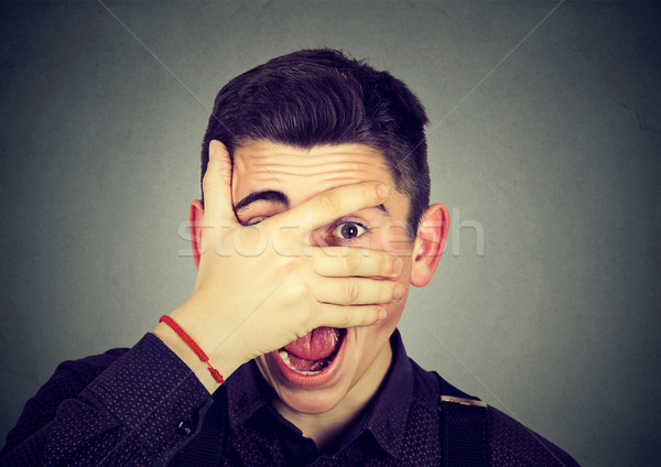 man looking surprised in disbelief, with hand on face looking at camera Stock photo © ichiosea