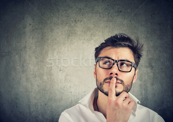 Pensive man trying to make decision Stock photo © ichiosea