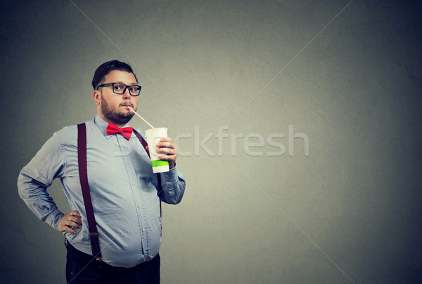 Man with overweight drinking sweet soda Stock photo © ichiosea