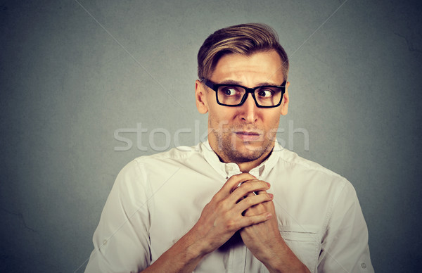 Nervous stressed man feels awkward anxiously craving something  Stock photo © ichiosea