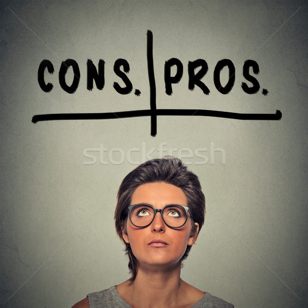 pros and cons, for and against argument concept. Woman deciding   Stock photo © ichiosea