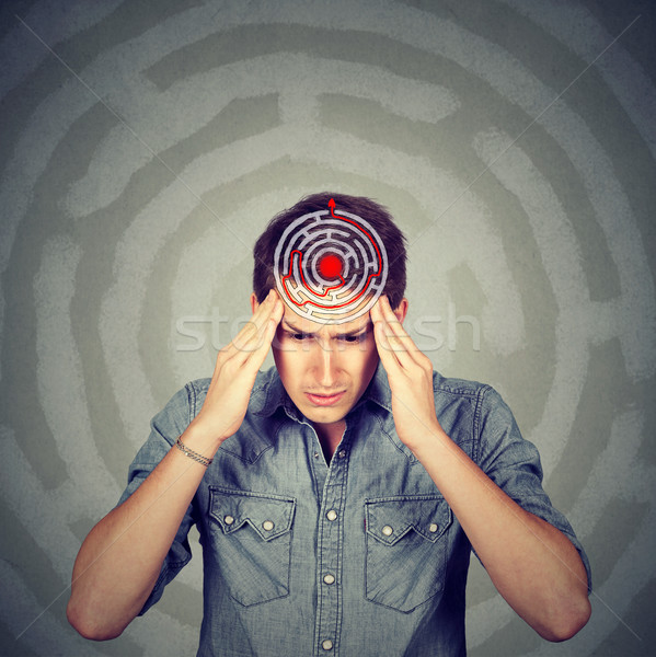 Problem solution concept. Young man solving puzzle  Stock photo © ichiosea