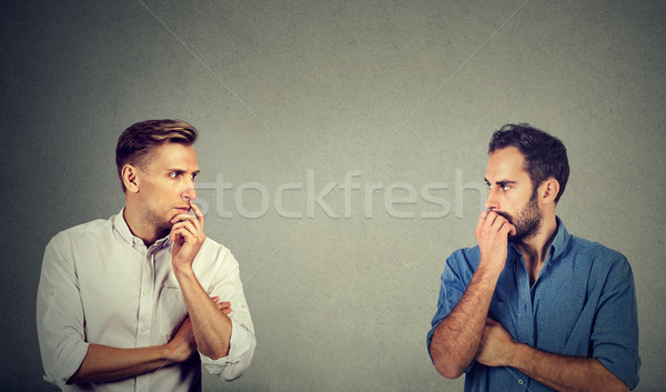 profile of two preoccupied businessmen looking at each other Stock photo © ichiosea