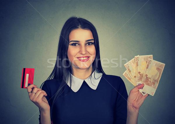 Woman shopping holding credit card and cash euro banknotes bills Stock photo © ichiosea