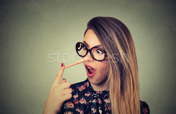 Woman with long nose. Liar concept. Human face expression emotion Stock photo © ichiosea