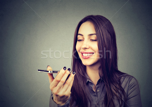 Girl using a smart phone voice recognition function on line  Stock photo © ichiosea