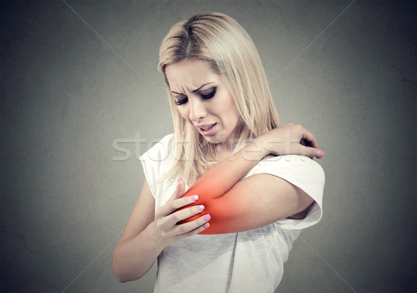 Sad woman with joint inflammation. Female's elbow. Arm pain and injury. Stock photo © ichiosea