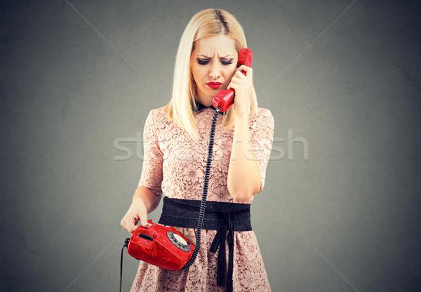 Triste mujer hermosa desagradable teléfono conversación hermosa Foto stock © ichiosea