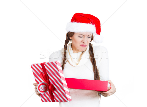 Portrait of a grumpy unhappy with her gift christmas woman Stock photo © ichiosea