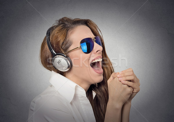 woman with sunglasses singing listening to music Stock photo © ichiosea