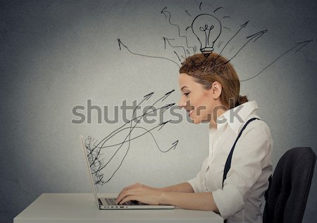 Stock photo: Young business woman working typing on computer in office