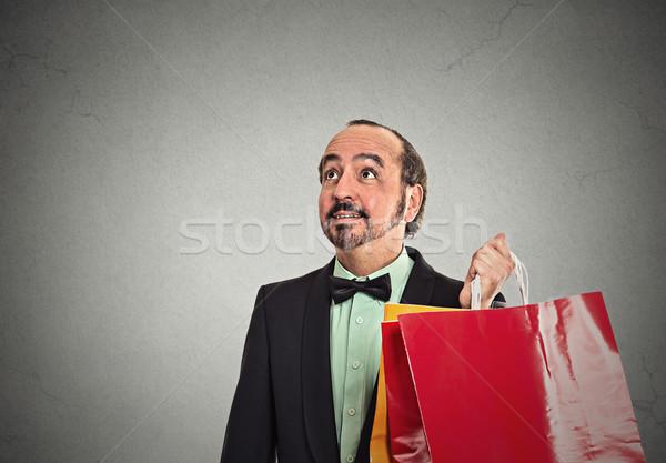 úriember tart bevásárlótáskák portré középkorú izolált Stock fotó © ichiosea