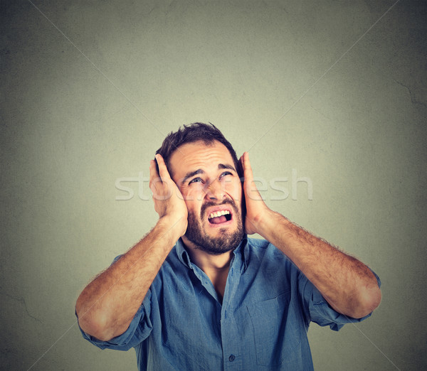 annoyed, stressed man covering his ears, looking up, stop making loud noise Stock photo © ichiosea