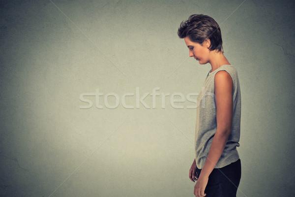 Strona profil smutne samotny młoda kobieta stałego Zdjęcia stock © ichiosea