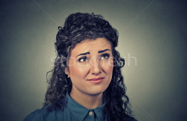 confused skeptical young woman thinking looking up Stock photo © ichiosea