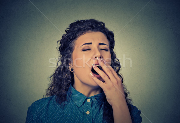 sleepy young woman with wide open mouth yawning eyes closed Stock photo © ichiosea