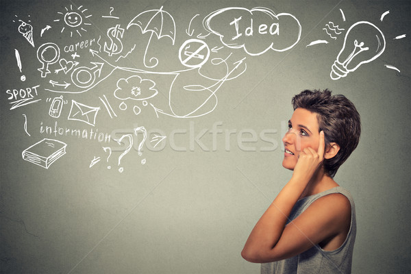 happy young woman thinking dreaming has many ideas looking up Stock photo © ichiosea