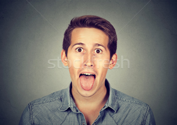 portrait of young man sticking out his tongue Stock photo © ichiosea