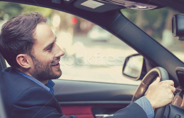 Feliz hombre manos rueda conducción coche nuevo Foto stock © ichiosea