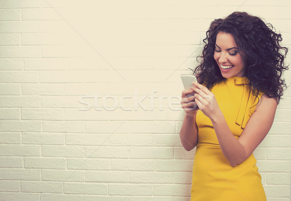 Woman using high-speed Internet connection texting on smart phone  Stock photo © ichiosea