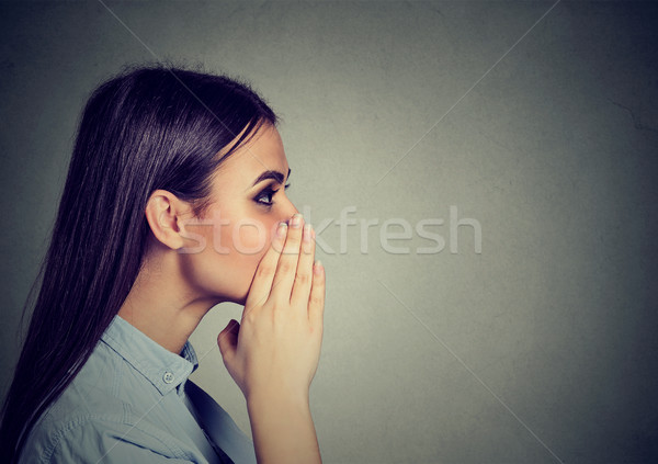 Closeup portrait of a woman whispering a gossip  Stock photo © ichiosea