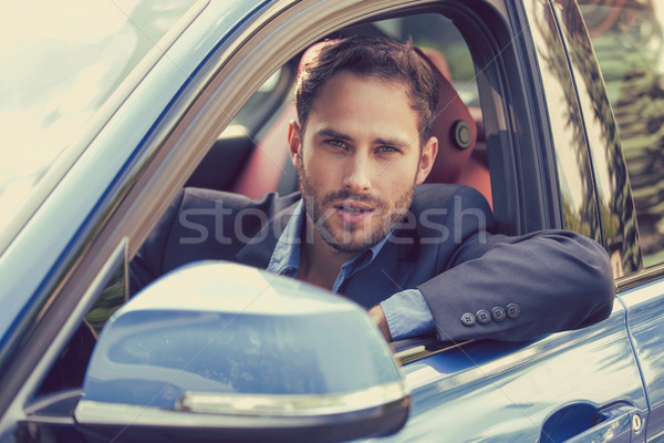 Happy man buyer sitting in his new car ready for trip.  Stock photo © ichiosea
