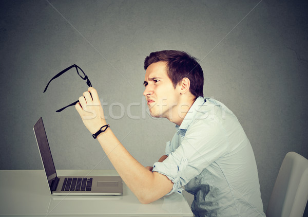 Business man with glasses having eyesight problems confused.  Stock photo © ichiosea