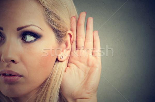 Kadın el kulak dikkatlice yalıtılmış gri Stok fotoğraf © ichiosea