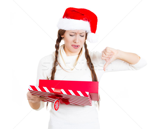 Christmas woman unhappy with a gift she received, showing thumbs down Stock photo © ichiosea