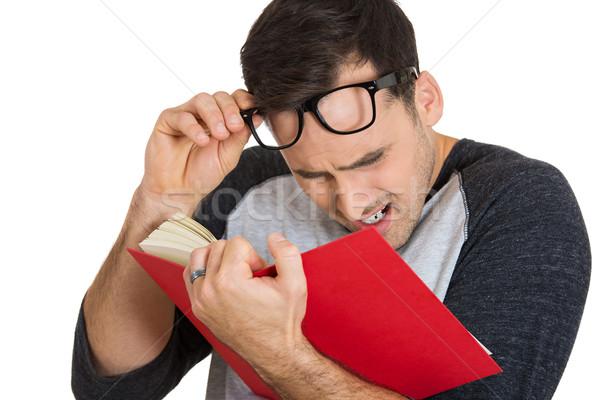 man trying hard to read Stock photo © ichiosea